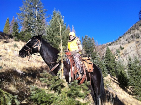 girl on horseback for Colorado elk hunt