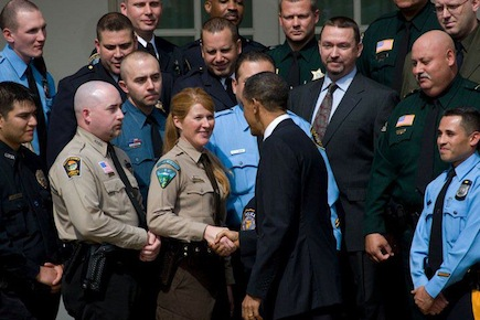 Alex Burke meets President Obama after being awarded a national Top Cop award with her involvement in a manhunt for a suspect in a shooting.