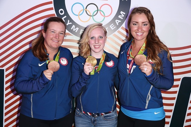 RIO DE JANEIRO, BRAZIL , Team USA, U.S. Olympians Kim Rhode, Virginia Thrasher and Corey Cogdell pose for a photo with their medals at the USA House at Colegio Sao paulo on August 5, 2016 in Rio de Janeiro, Brazil. (Photo by Joe Scarnici/Getty Images) *** Local Caption *** Kim Rhode; Virginia Thrasher; Corey Cogdell