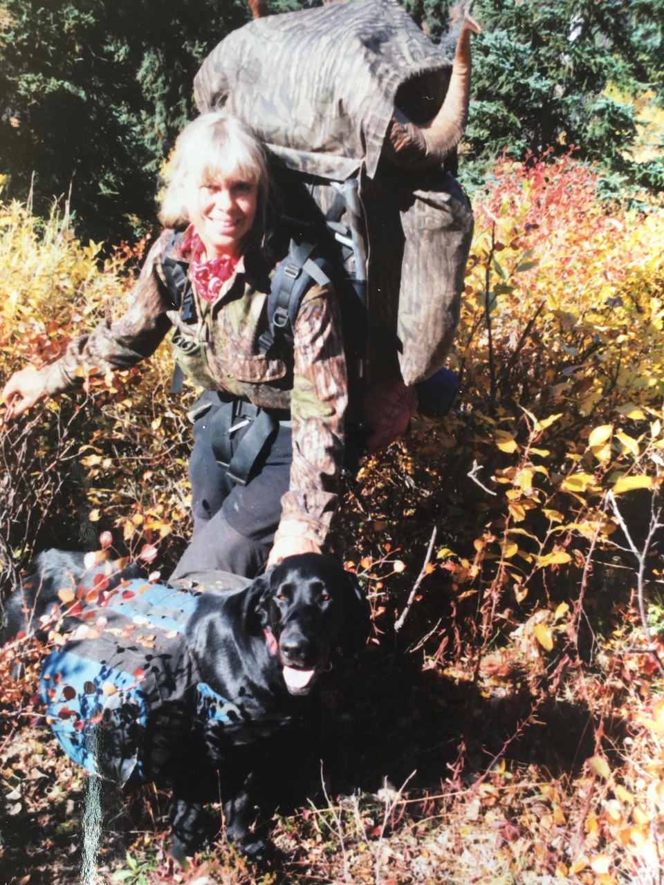 Sue Entsminger and pack dog, Midnight. She was an awesome super dog.