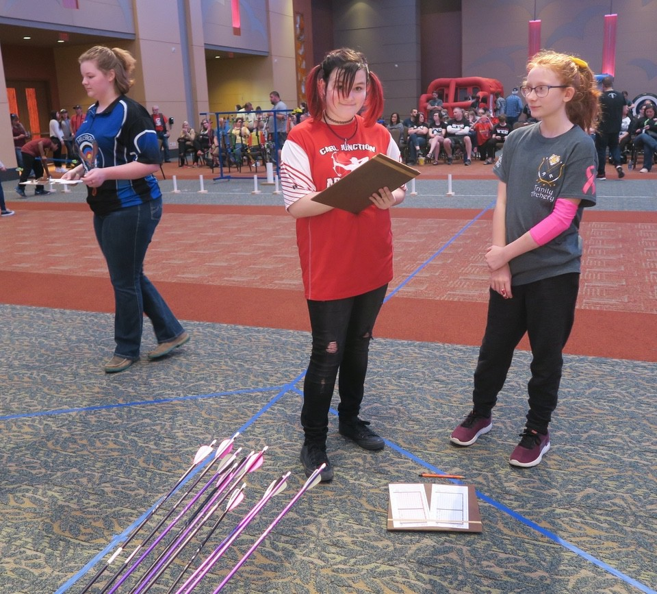 Girls scoring 3D archery