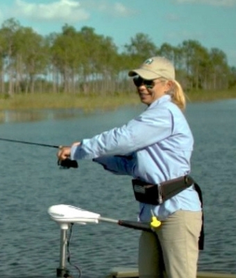 feature woman fishing rod