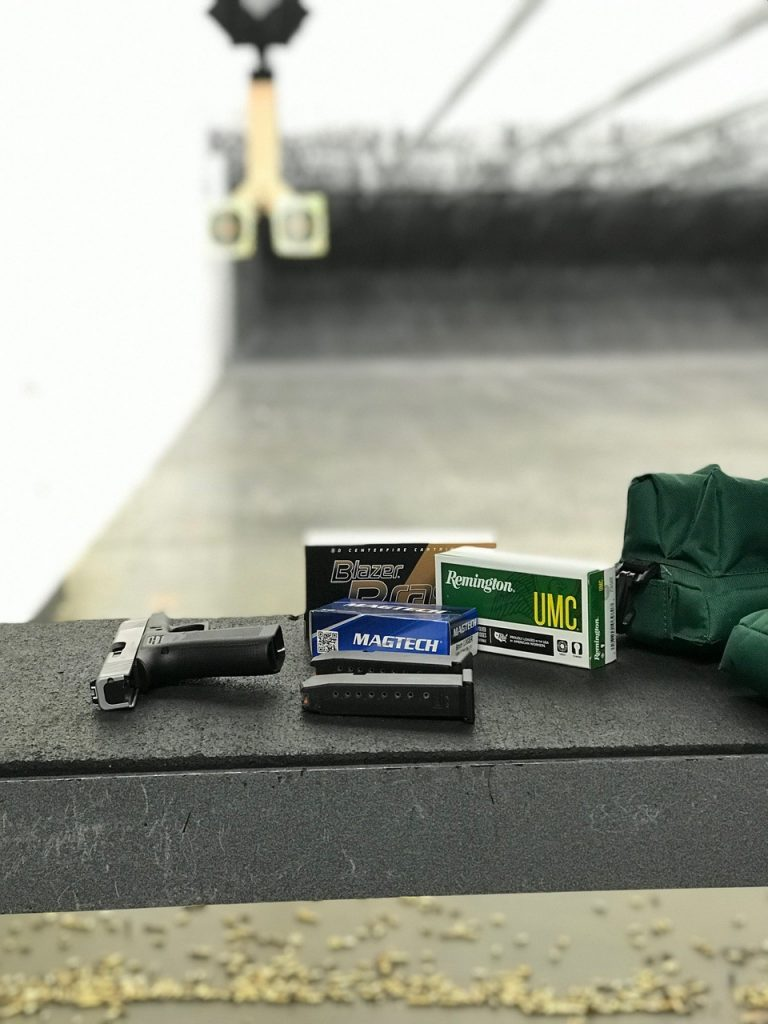 Glock 43X on bench at range with ammo
