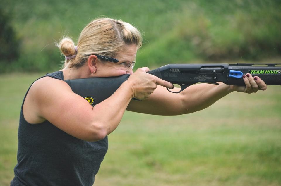 Yackley shooting shotgun