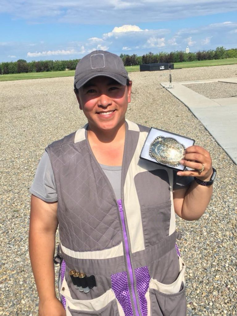 Syren Trap Shooter Emi Smith with belt buckle