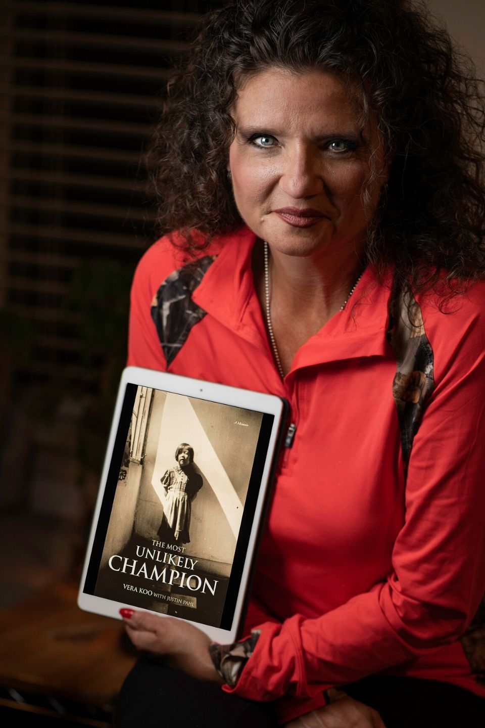 Jennifer Hansen Reviews Vera Koo's Book, The Most Unlikely Champion.