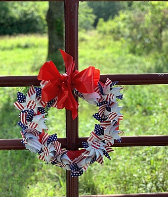 Patriotic Pinwheel Wreath on Gate Featured feature