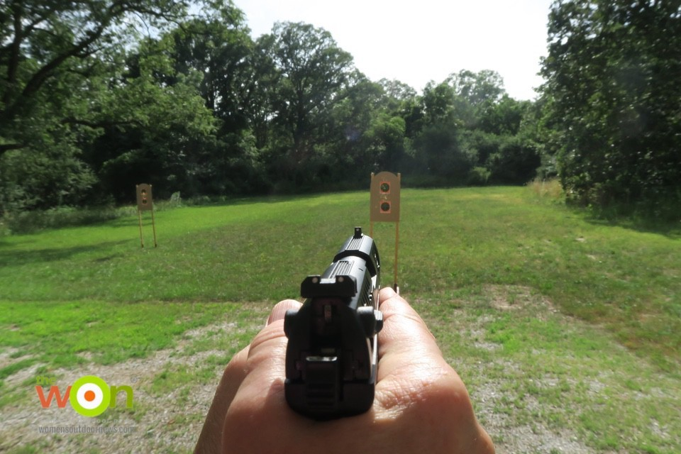 Shooting a beginner firearm on the range