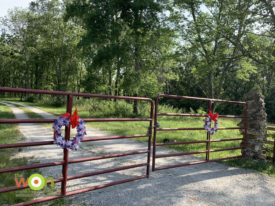 gates with pinwheel wreaths for Fourth of July