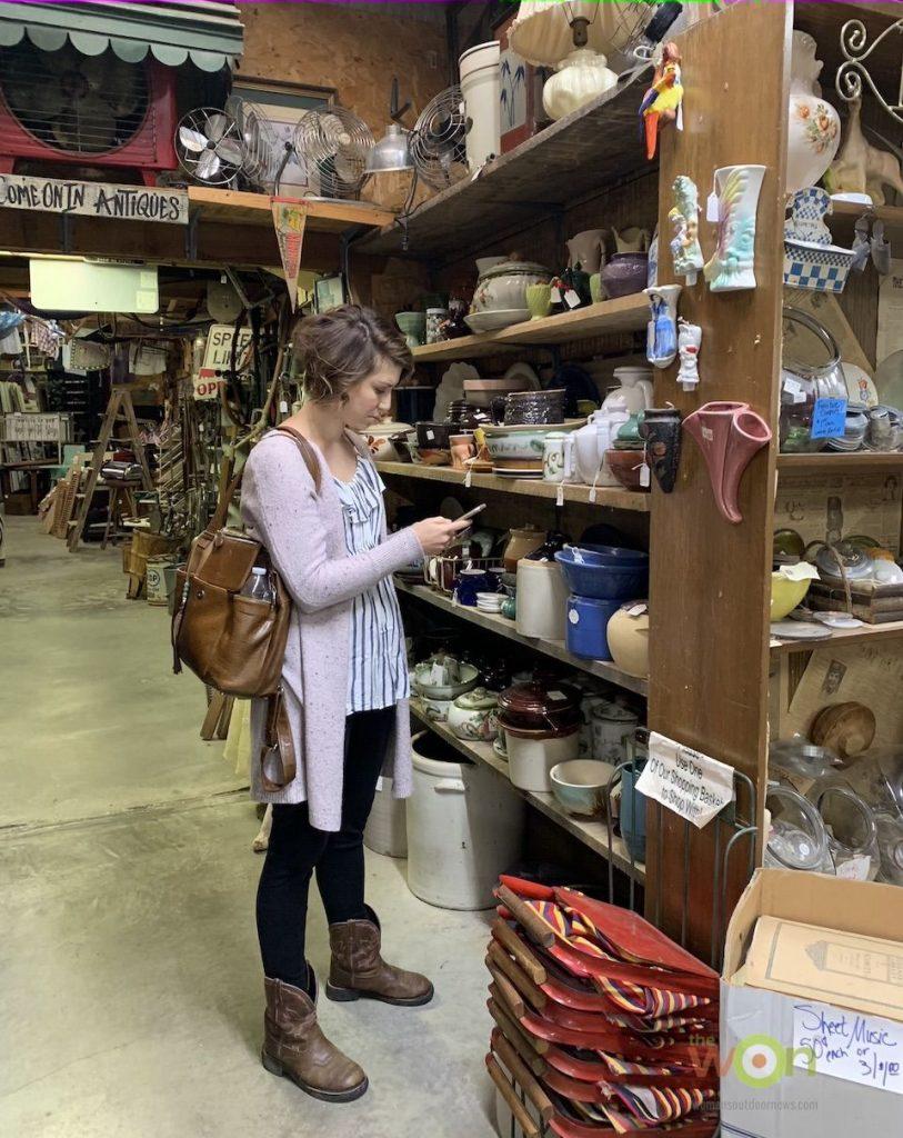 woman antiques shop