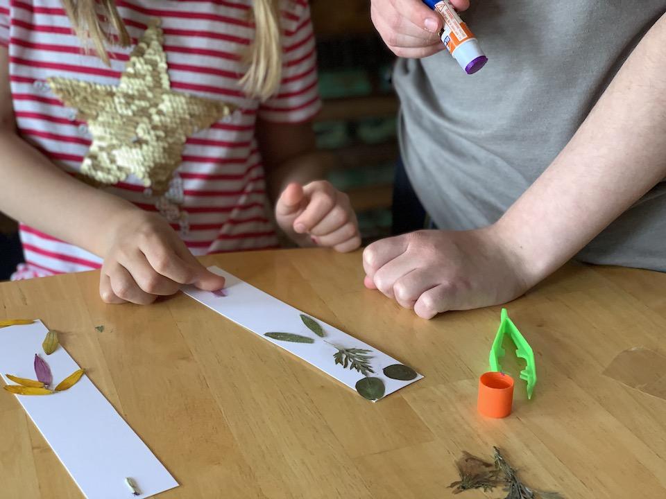glue petals to paper bookmarks