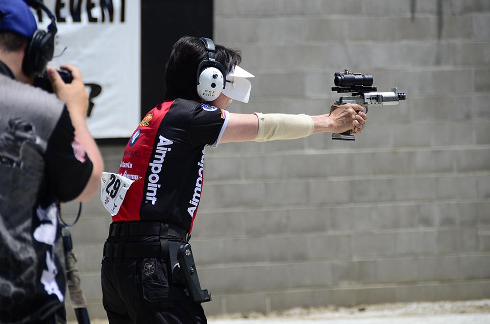 Vera Koo Aimpoint scope on Bianchi Cup gun