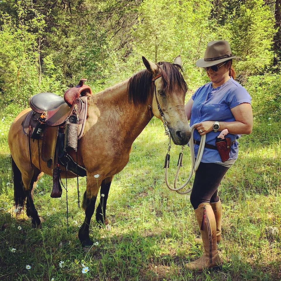 Courtney Bastian The Bird Dog Babe on horse