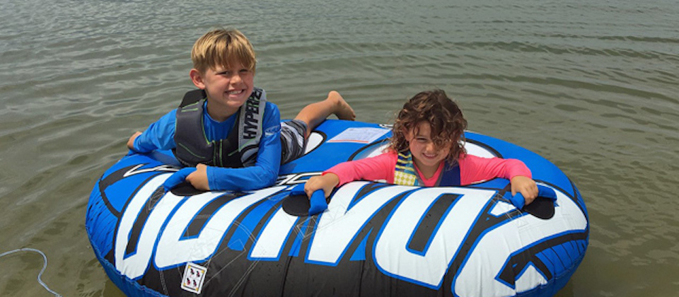 Summer Family Outdoor Activities kids on a tube