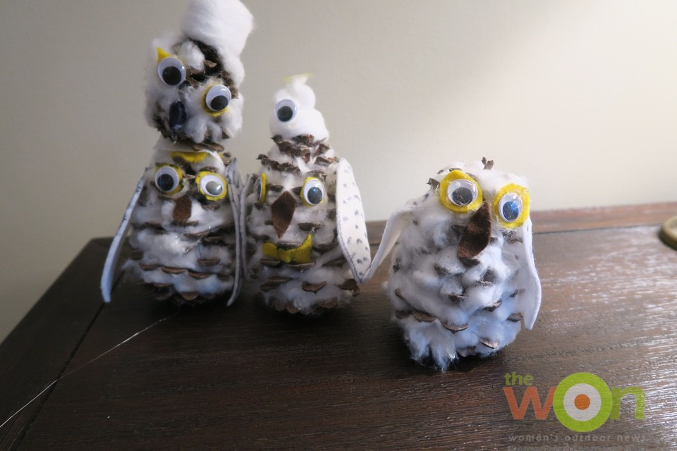 pinecone snowy owls in a line