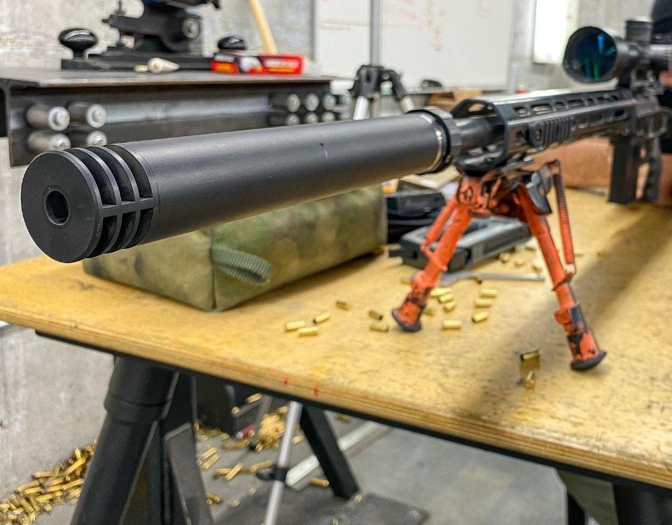 Suppressor on rifle SilencerCo POI Shift