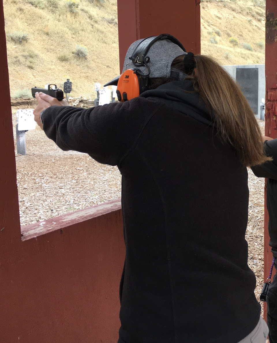 Kelly shooting a Glock 19 with Red Dot at TWAW conference