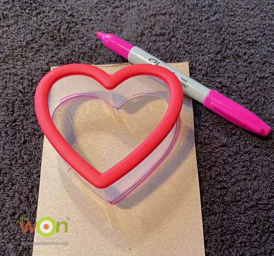 pen and heart cutter