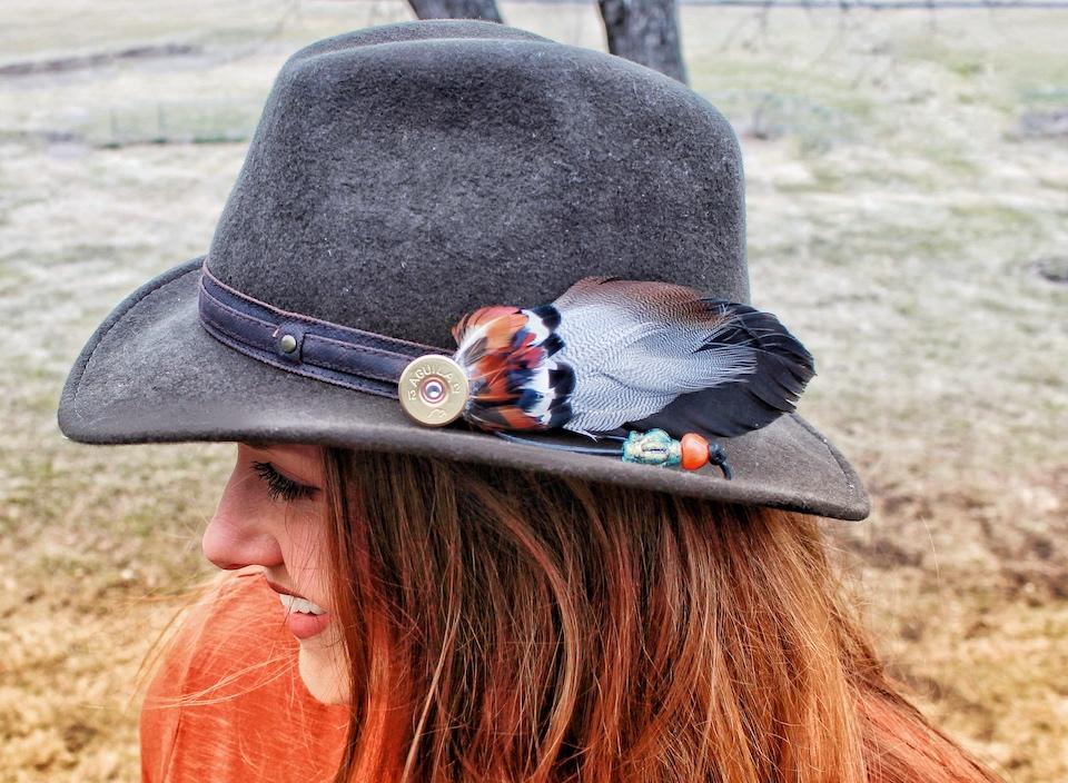 pheasant feather pendant on hat