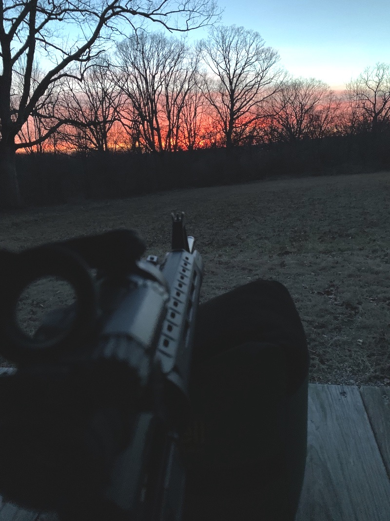 on the range at sunset with ar How a Suppressor Reduces Flash