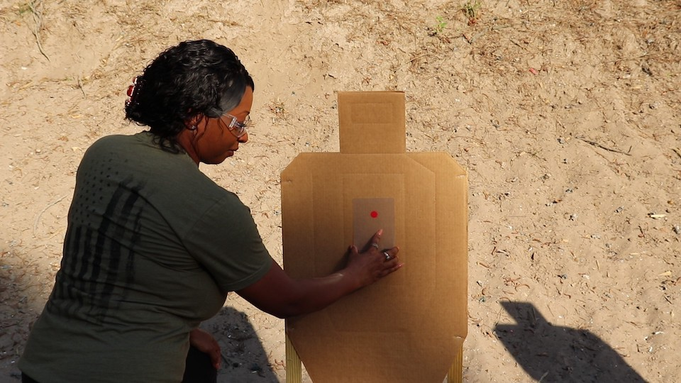 Red Dot training aid super imposed onto target