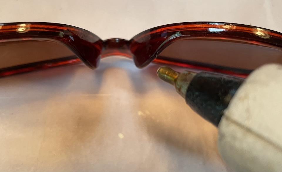 add hot glue to sunglasses
