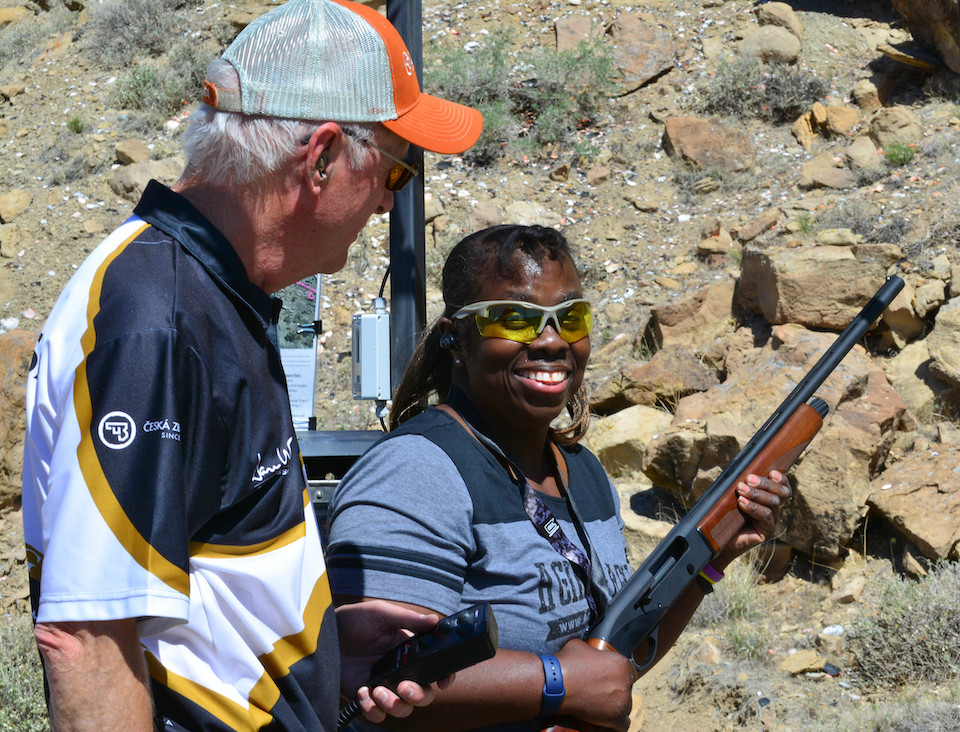 Candy Petticord enjoying her shotgun lesson from Ed.