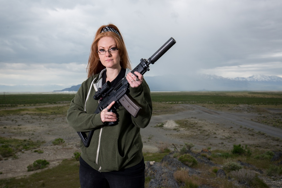 woman outside with silencerco on AR Female Initiative