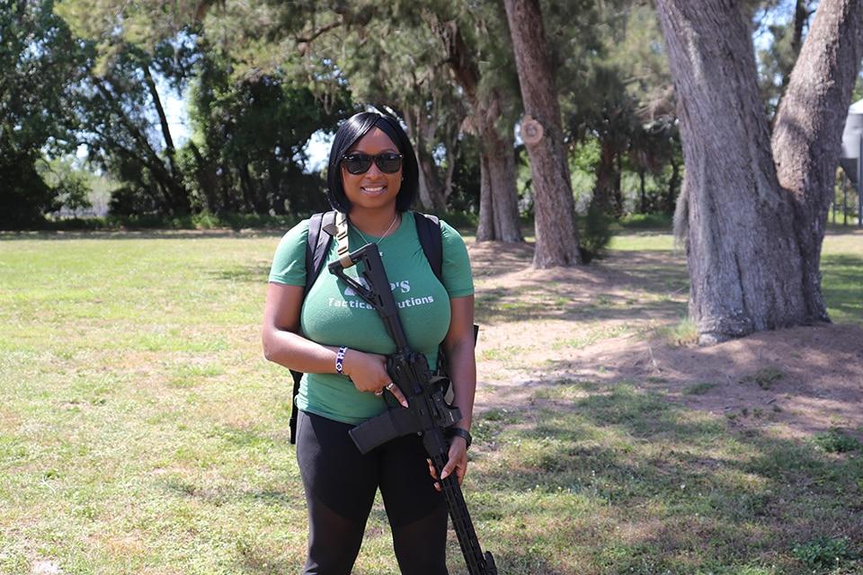 Avery Skipalis with rifle