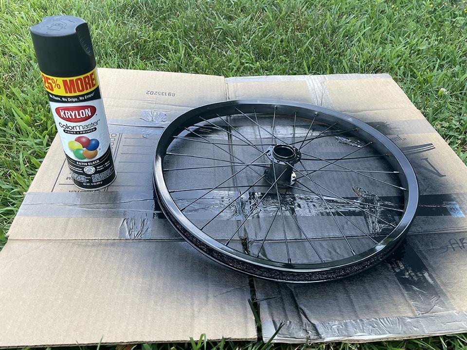 Spray painting the bike wheel