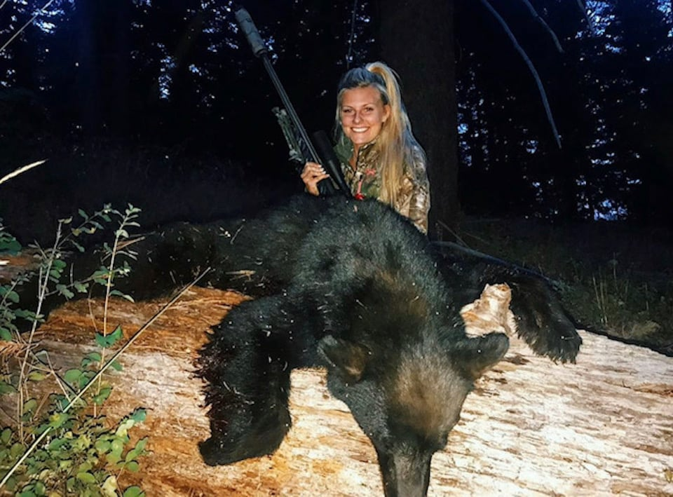 Harvested Bear with a Suppressor