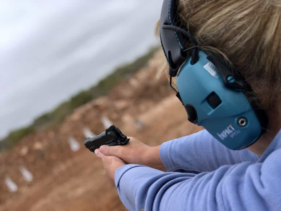 woman practicing for concealed carry