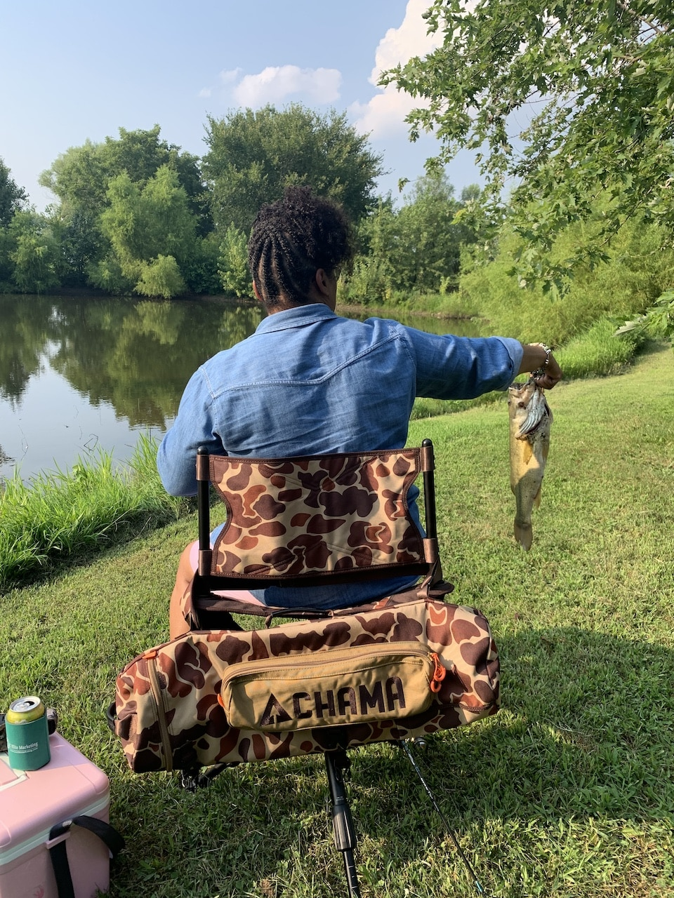 Sharenda caught a bass in her CHAMA Pursuit Chair