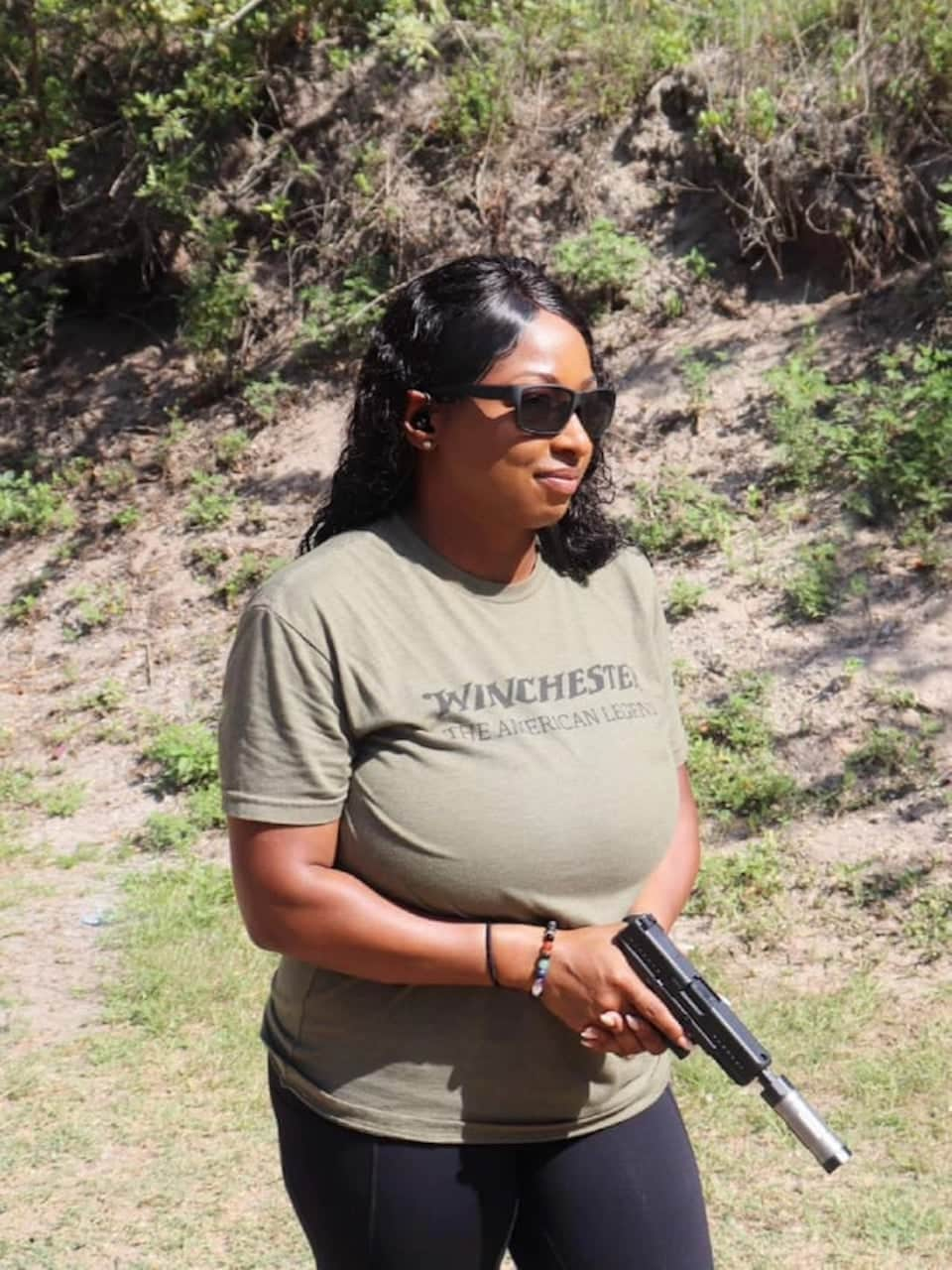 Avery Skipalis shooting GLOCK 44 with a SilencerCo Switchback 22 on it