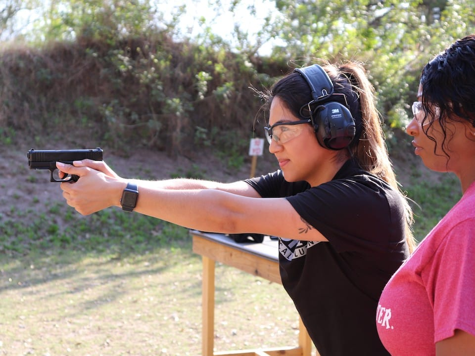 Avery with female student shooting G44